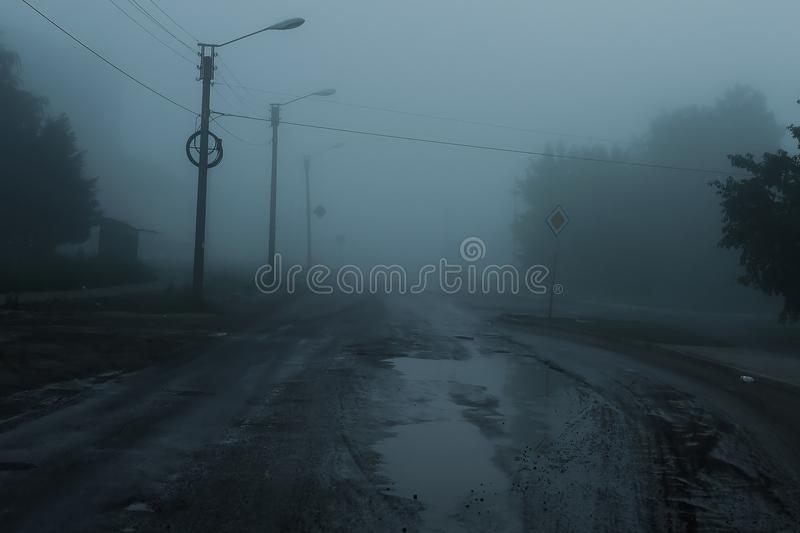 Terrible foggy road. Silhouette of a lonely man standing on the foggy road stock images