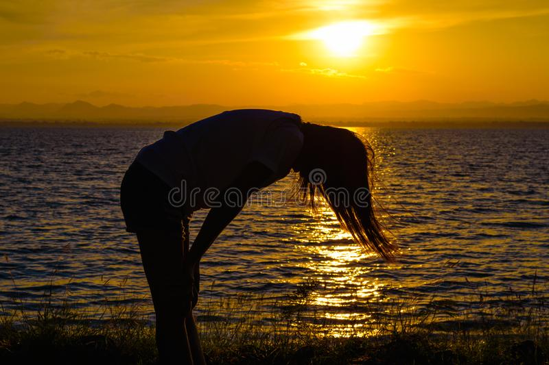 The silhouette of Long-haired woman royalty free stock photography