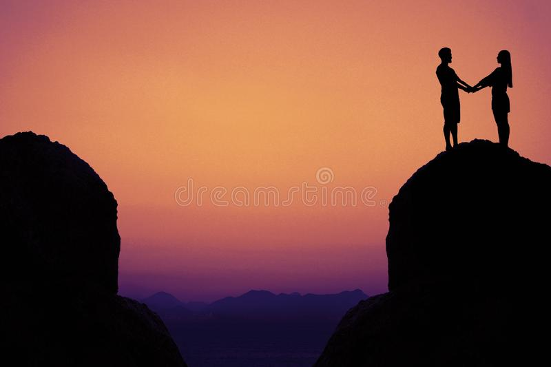 Silhouette of a love couple in mountains as symbol for love and stock photos