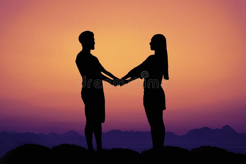 Silhouette of a love couple at sunset as symbol for wedding royalty free stock photo