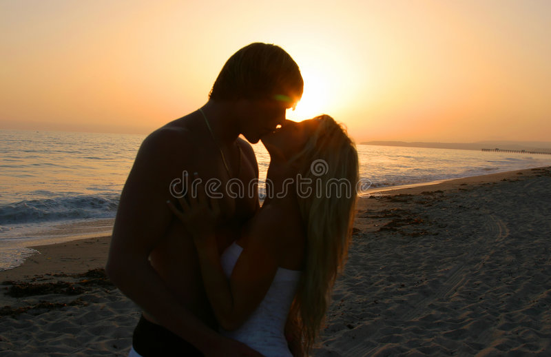 Silhouette Lovers Kissing on tne Beach. At Sunset stock photos