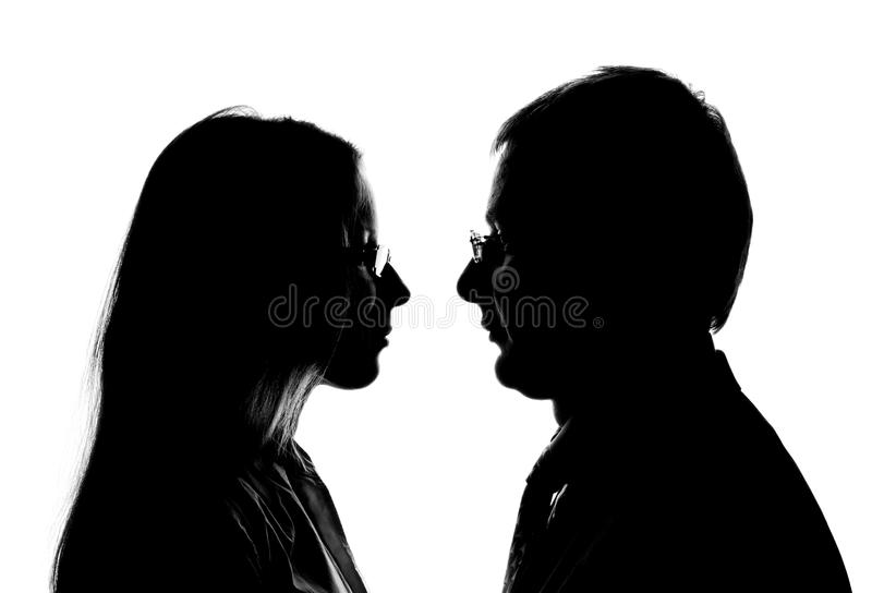 Silhouette of loving couple stock images