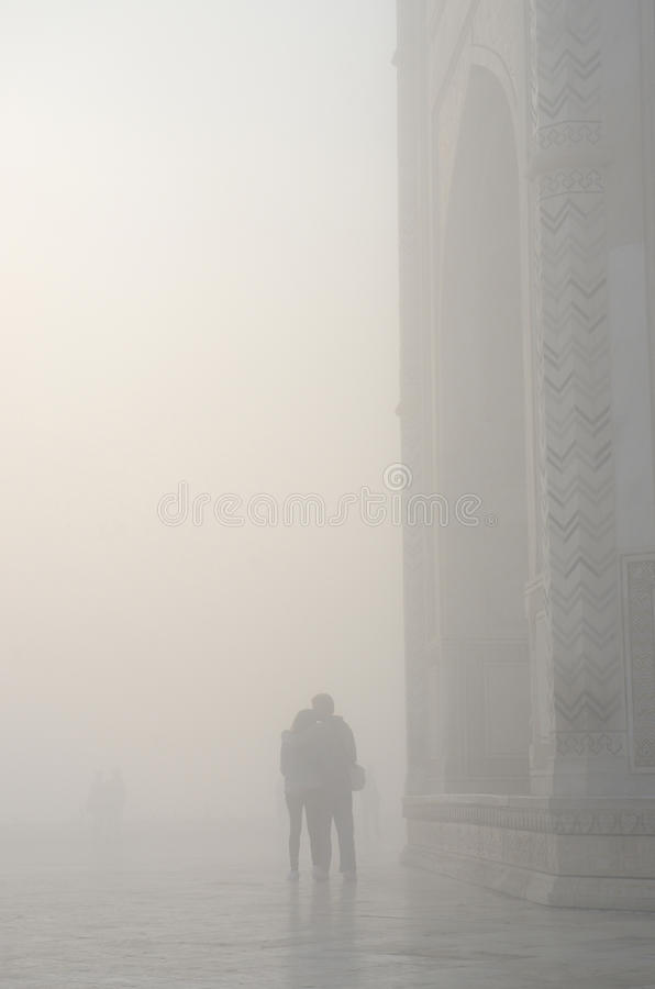 Silhouette of loving couple in a haze ,near Taj Mahal,India stock images