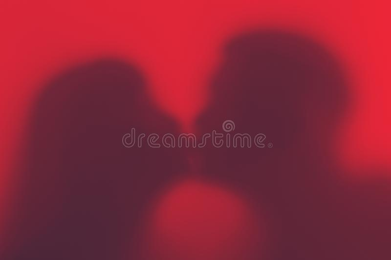 Silhouette of a loving couple during a kiss. Silhouette of lover royalty free stock image