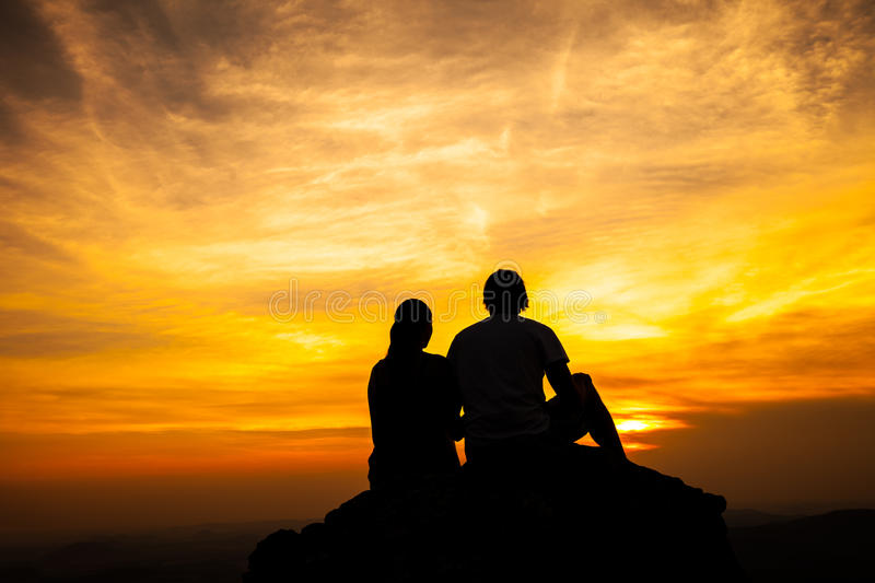Silhouette of loving couple in sunset stock image