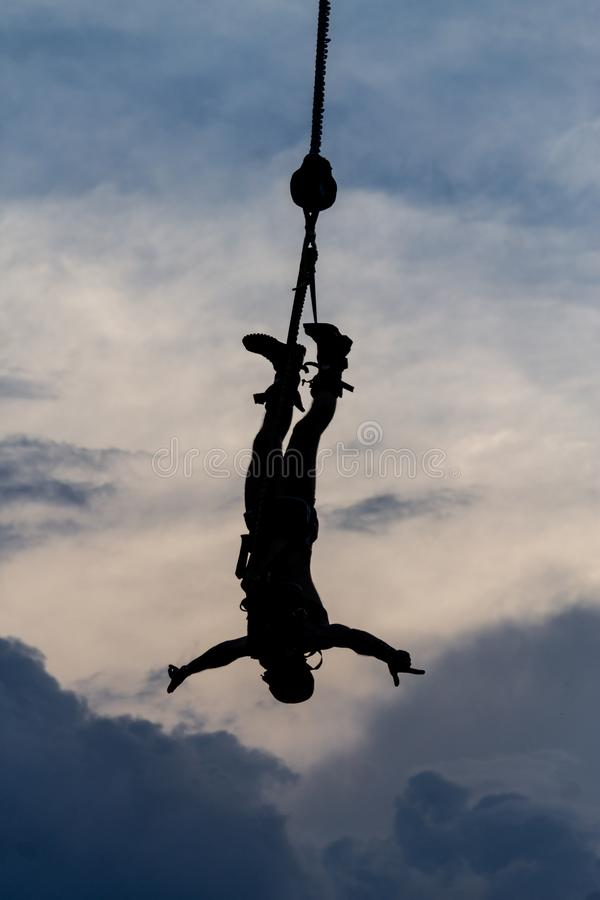 Silhouette of a male Bungee Jumper stock images