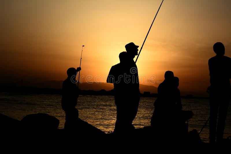 Silhouette male fisherman stock images