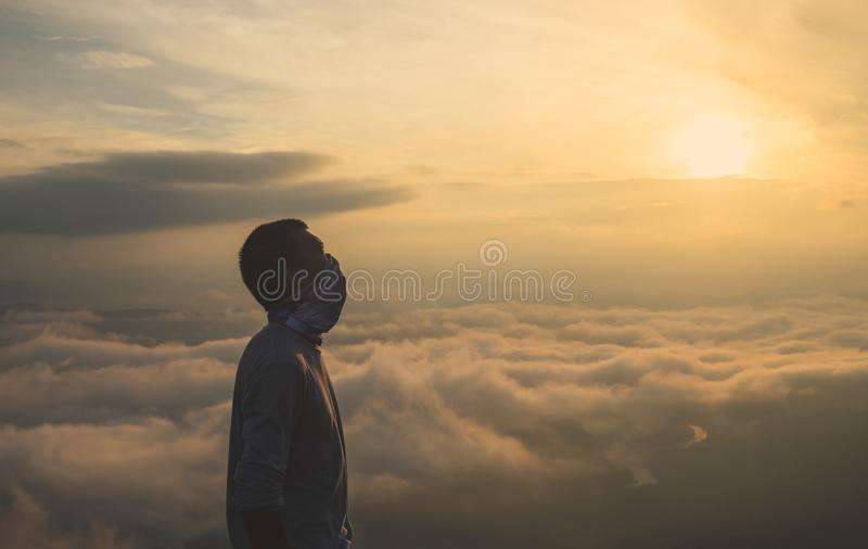 Silhouette of male in sunrise background. Summer vacation and travel concepts royalty free stock photography