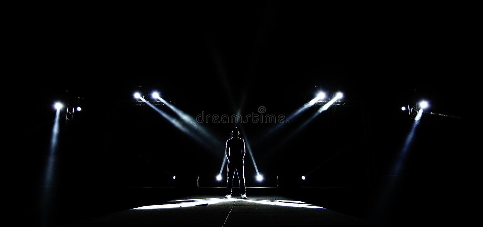 Silhouette of Male surround with Light, Dark Low Exposure, concept Unique Confidence royalty free stock photography