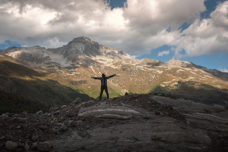 Silhouette of a man on a background of a mountain landscape stock photo
