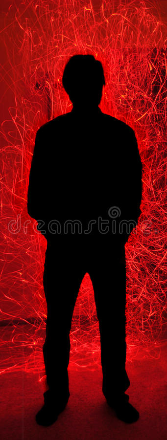 Free Silhouette Man Behind Red Fire Sparks Inferno Royalty Free Stock Image - 12258296