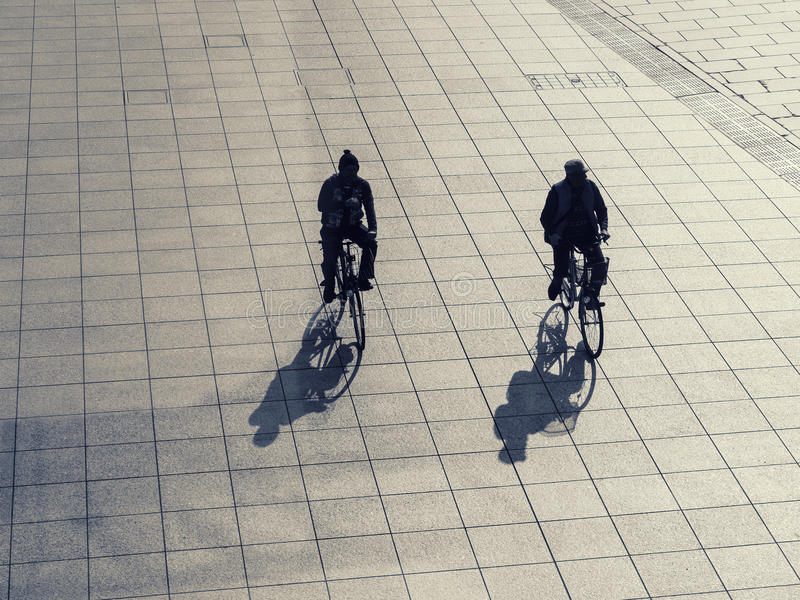 Silhouette man on bicycle outdoor Urban lifestyle. Background stock photo