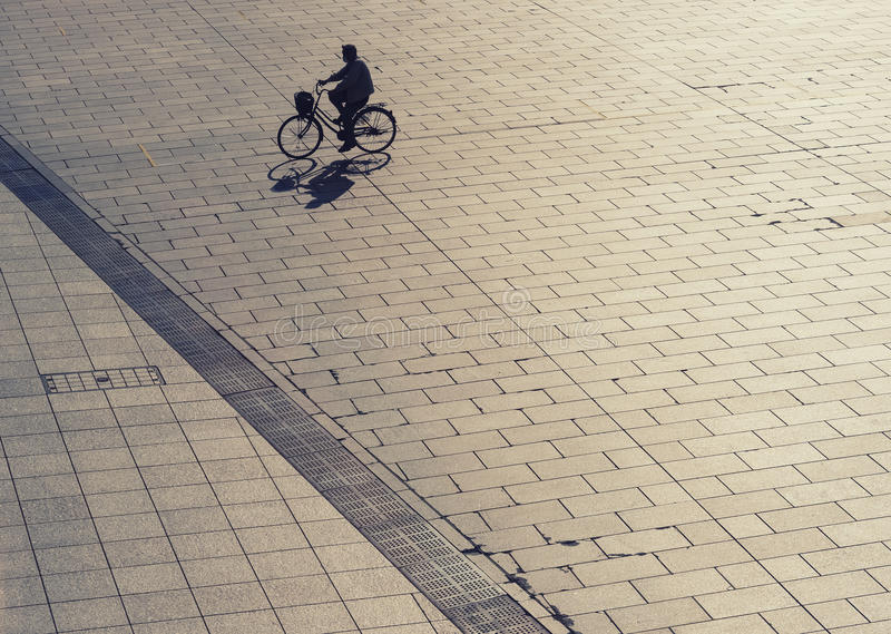 Silhouette man on bicycle outdoor Urban lifestyle Top view royalty free stock photo