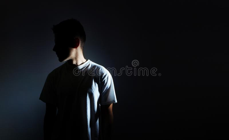 Silhouette of man on black background, dark portrait, profile, male depression royalty free stock photo