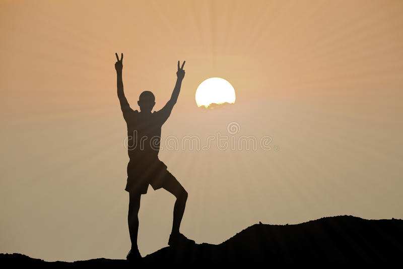 Silhouette of man is climbing to peak of hill royalty free stock images