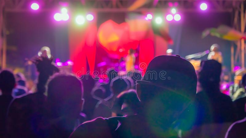 Silhouette of man in the crowd in baseball cap on reggae concert royalty free stock photos