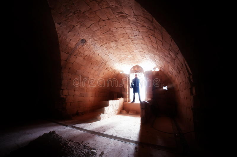 Silhouette of man in crypt royalty free stock photography