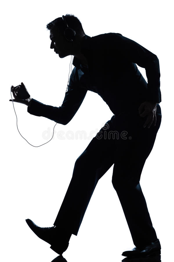 Silhouette man dancing listening to music royalty free stock image