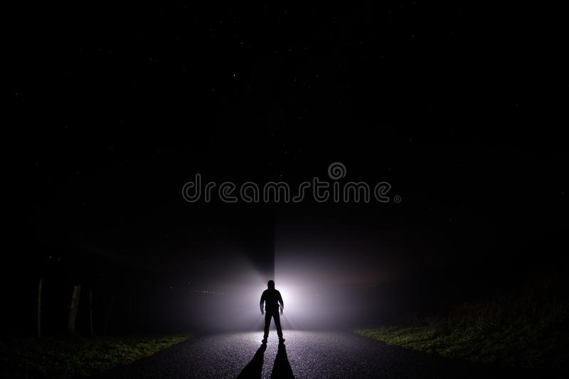 Silhouette of a man in the darkness stock photography