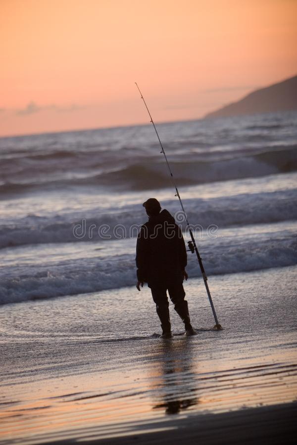 Silhouette of Man Fishing royalty free stock images