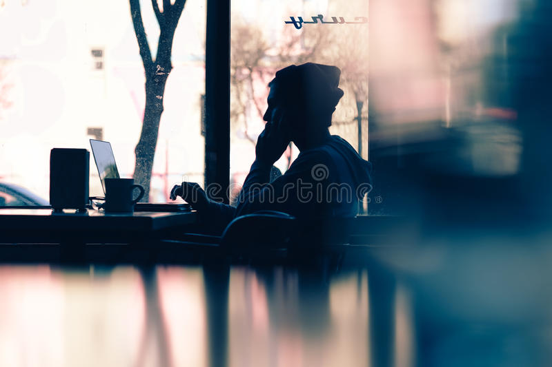 Silhouette Of Man In Front Of Laptop Near Window During Daytime Free Public Domain Cc0 Image