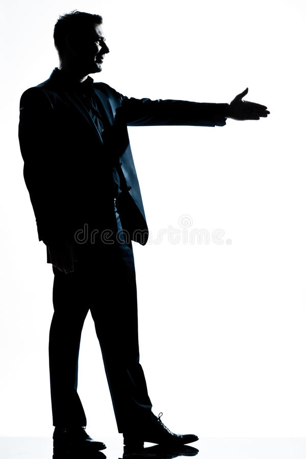 Silhouette man full length handshake profile. One caucasian man handshake profile full length silhouette in studio isolated white background royalty free stock images