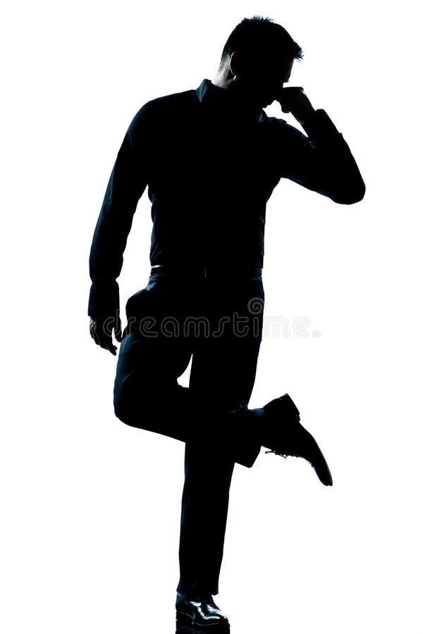 Silhouette Man Full Length Looking At His Shoes Stock Photo