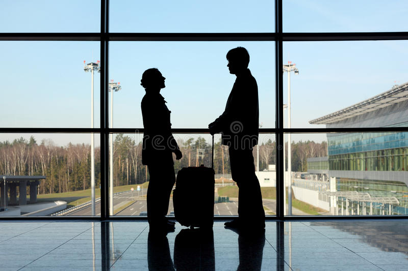 Silhouette Of Man And Girl With Luggage Royalty Free Stock Photography