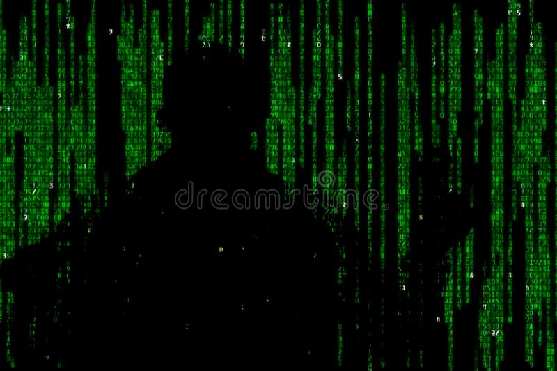 Silhouette of man in green digital data. The symbol of a hacker. Silhouette of man in green digital data. The symbol of a hacker stock photography