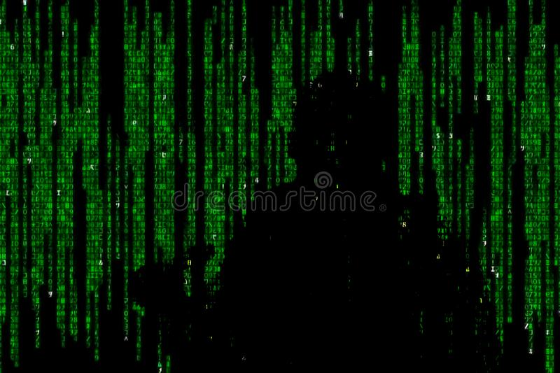 Silhouette of man in green digital data. The symbol of a hacker. Silhouette of man in green digital data. The symbol of a hacker royalty free stock images