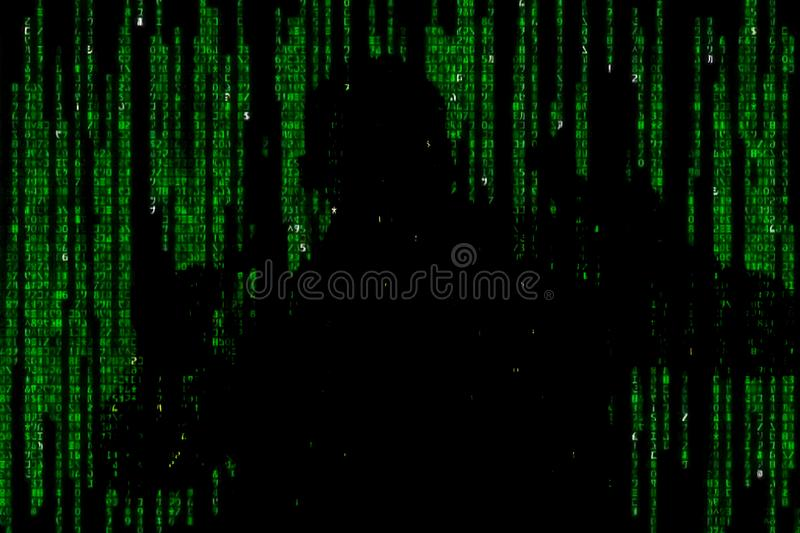 Silhouette of man in green digital data. The symbol of a hacker. Silhouette of man in green digital data. The symbol of a hacker royalty free stock photos