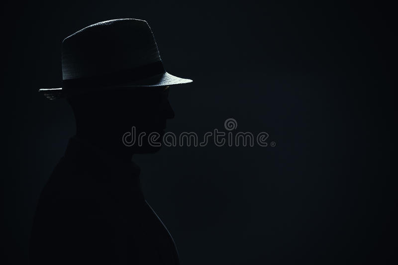 Silhouette of a Man With Hat stock photography