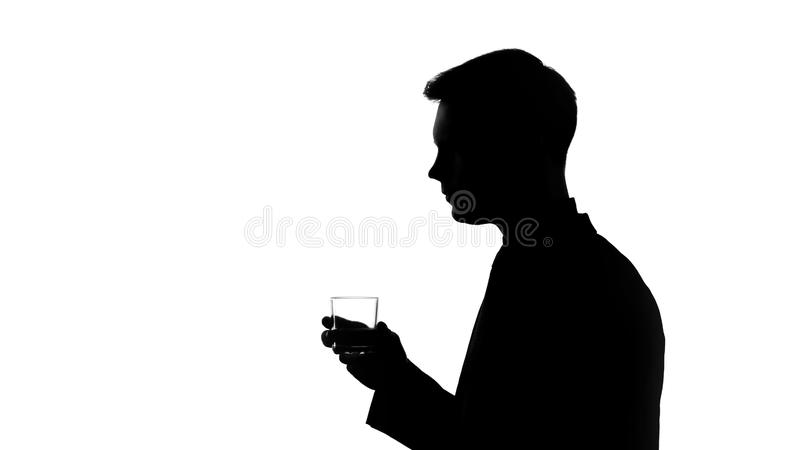 Silhouette of man holding glass with beverage, saying toast, corporative party stock images