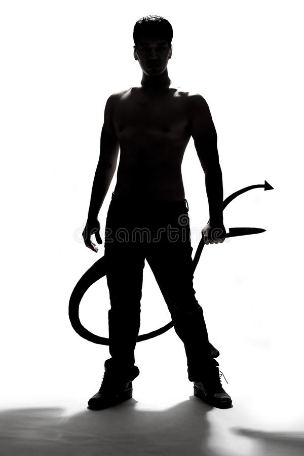 Silhouette of a man holding knife stock photos