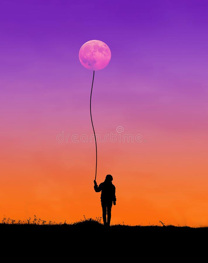 Silhouette of Man Holding String Connected to Moon royalty free stock image
