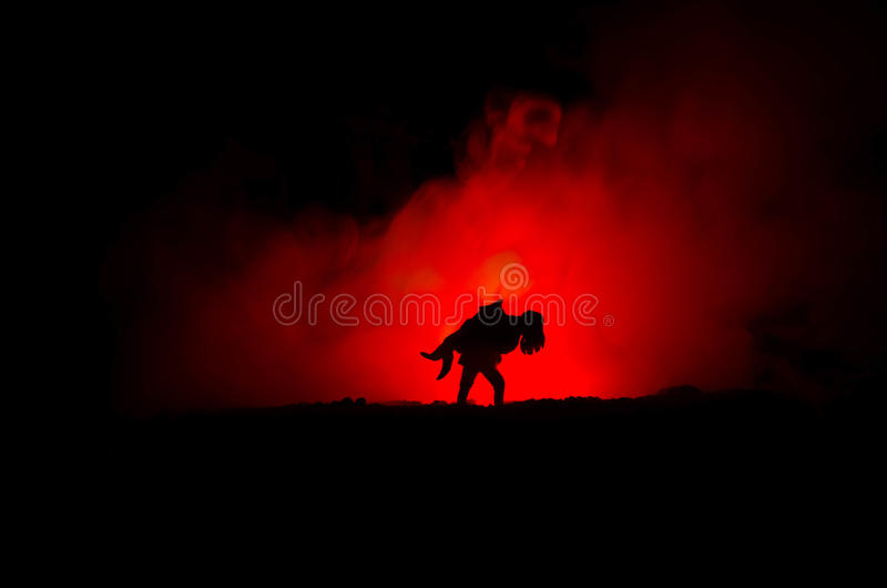 A silhouette of a man holding on to the woman. Rescue saviour concept. Escape from fire or danger. Hourglass, Fire. A silhouette of a man holding on to the woman royalty free stock photos