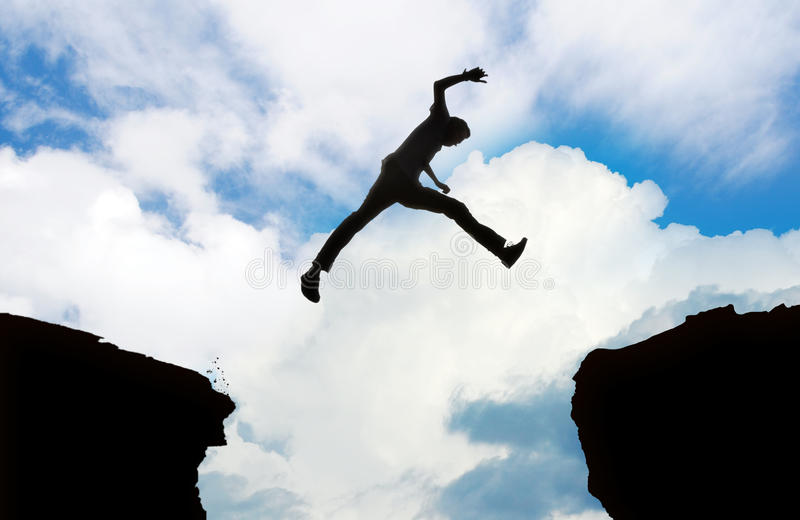 Silhouette of man jumping stock photos