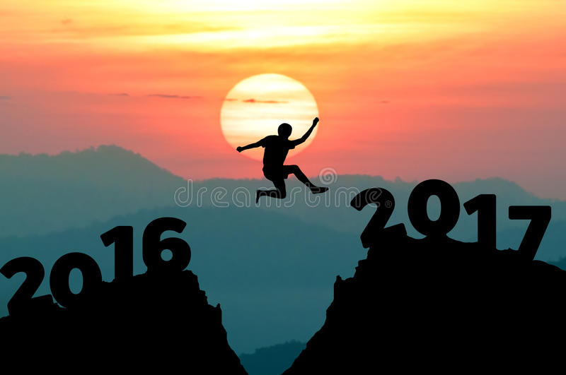 silhouette man jumps to make word Happy New Year 2017 with sunrise. (New Year 2017 is coming concept.) royalty free illustration