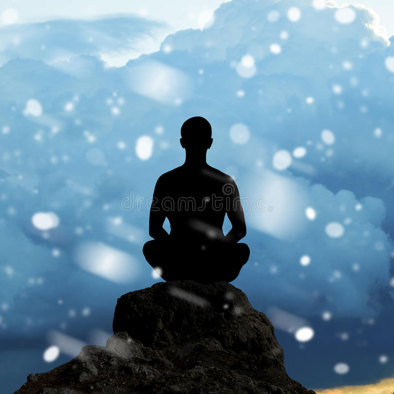 Silhouette of a man meditating in Lotus position royalty free stock photo