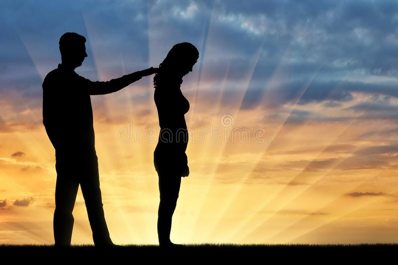 A silhouette of a man morally supports a sad woman royalty free stock images
