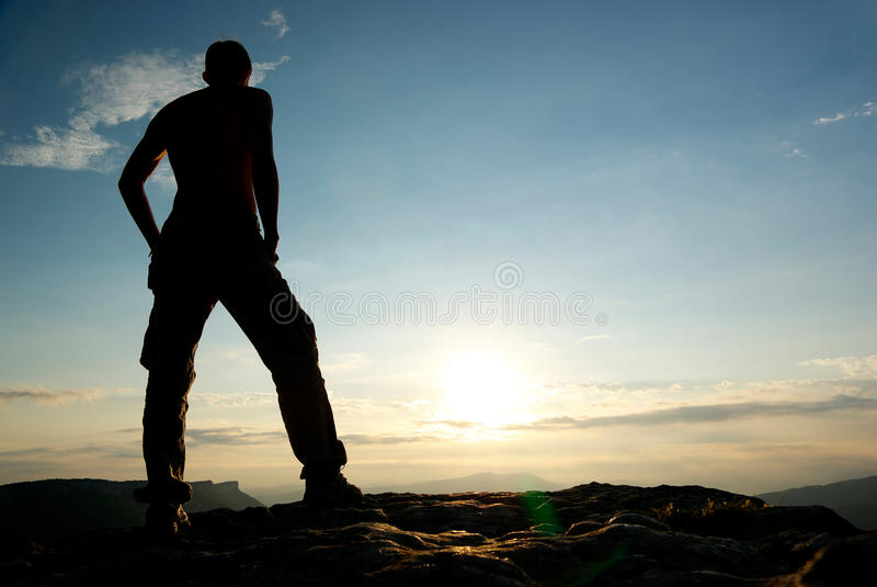 Silhouette of man in mountain. stock photo