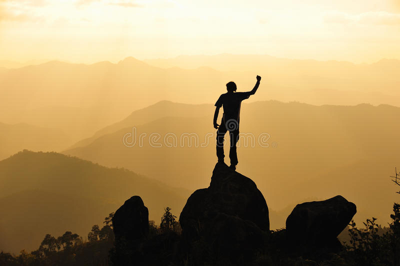 Silhouette of man in mountain. Conceptual royalty free stock image