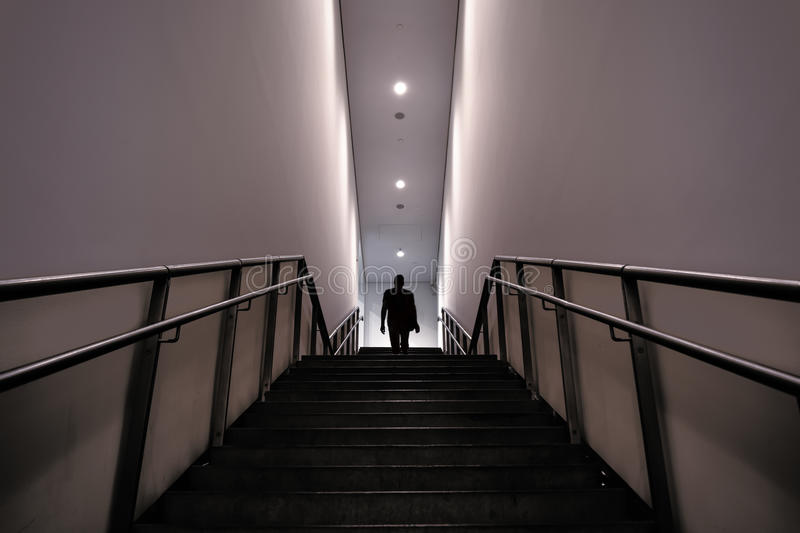 Silhouette of a man in mysterious stairs stock images