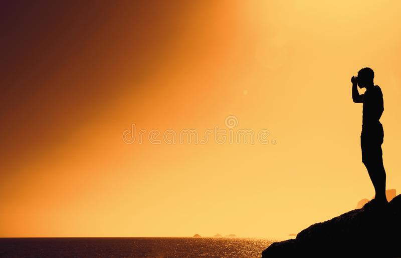 Silhouette of a man on hill with copy space as symbol for success royalty free stock image