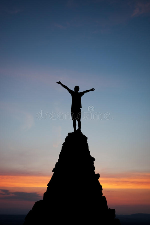 Silhouette of man on peak royalty free stock photography