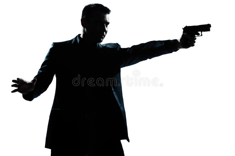 Silhouette man portrait with gun aiming royalty free stock images