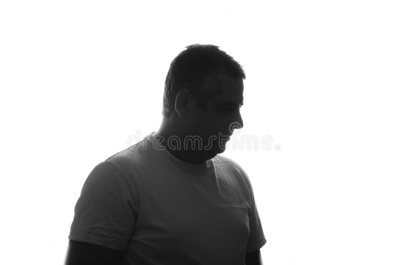 Silhouette of man portrait in shirt with hand on studio isolated white background. Close up. place for text.  stock photography