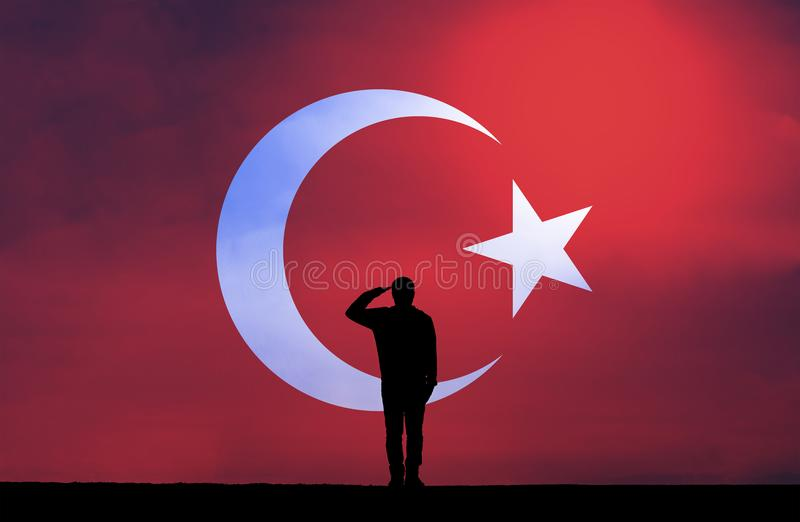 Silhouette of a man Saluting Against The Turkish Flag royalty free stock image