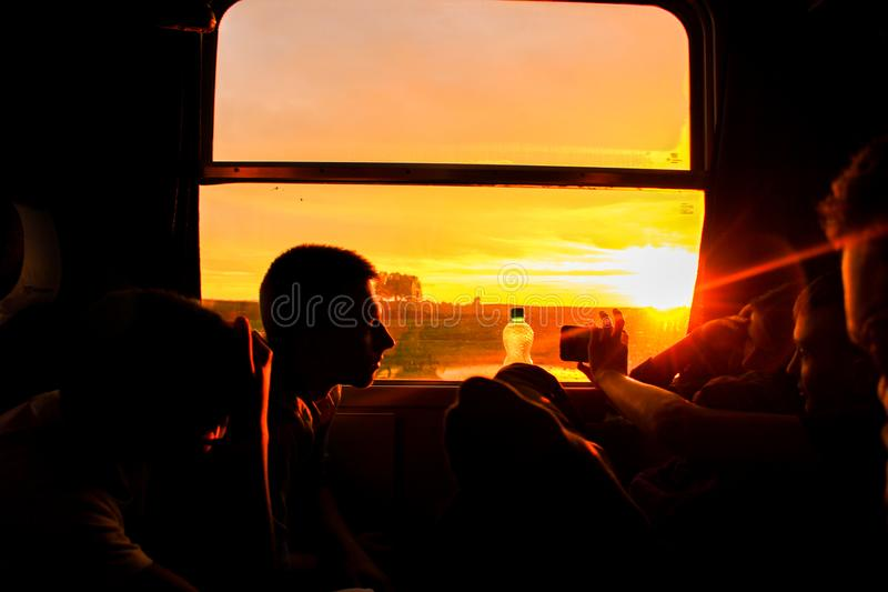 Silhouette of Man Sitting during Sunset royalty free stock images