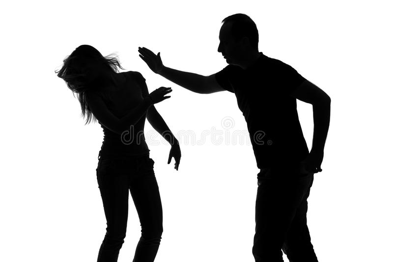 Silhouette of a man slapping a woman. Silhouette of a men slapping a women isolated against white background stock image